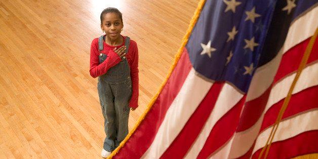 Girl reciting the pledge of allegiance