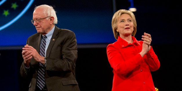 Hillary Clinton, former Secretary of State and 2016 Democratic presidential candidate, right, and Senator Bernie Sanders, an