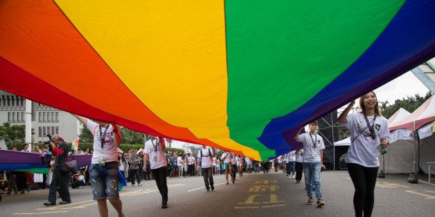 TAIPEI, TAIWAN - 2015/10/31: The rainbow flag, a symbol of gay rights, leads off the annual LGBT pride march. Upwards of 60 0