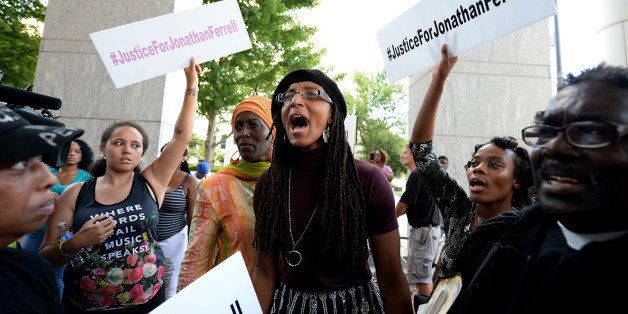 A young woman yells, 'black lives matter,' with other protesters at the Mecklenburg County Courthouse on Friday, August 21, 2
