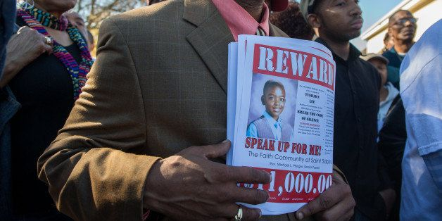 The Saint Sabina church and other area churches offer a reward at the site where Tyshawn Lee, 9, was fatally shot in Chicago'