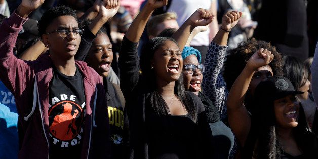 FILE - In this Nov. 9, 2015, file photo, students cheer while listening to members of the black student protest group Concern