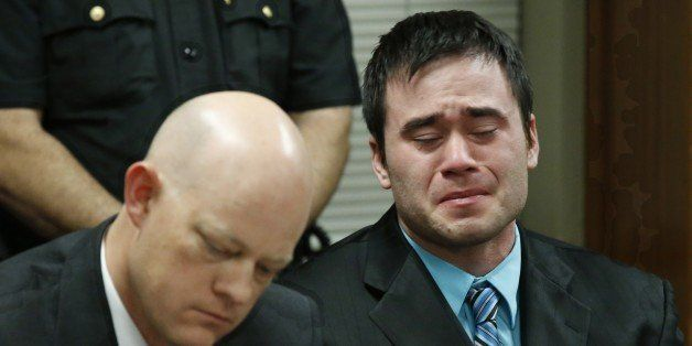 Daniel Holtzclaw, right, cries as the verdicts are read in his trial in Oklahoma City, Thursday, Dec. 10, 2015. At left is de