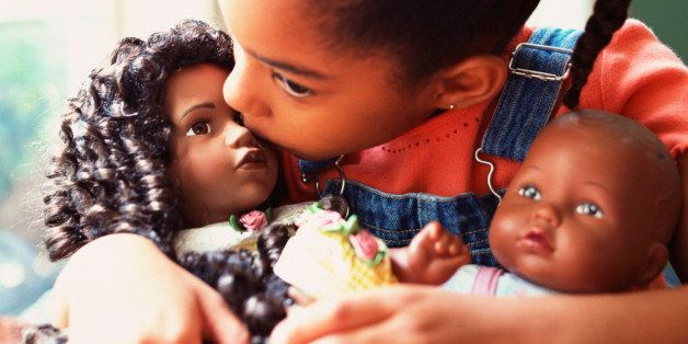 Girl kissing dolls