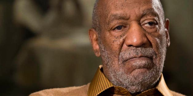 FILE - In this Nov. 6, 2014 file photo, entertainer Bill Cosby pauses during an interview in Washington about an upcoming exh
