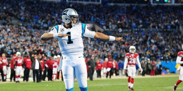 CHARLOTTE, NC - JANUARY 24: Cam Newton #1 of the Carolina Panthers celebrates after a score against the Arizona Cardinals dur