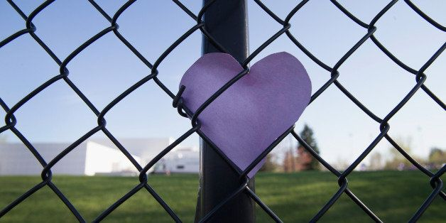 CHANHASSEN, MN - APRIL 22:  A puple heart left by a fan is tucked into the fence which surrounds Paisley Park, the home and s
