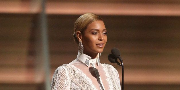 Beyonce presents the award for record of the year at the 58th annual Grammy Awards on Monday, Feb. 15, 2016, in Los Angeles.