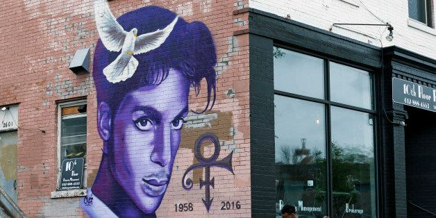 A mural honoring the late rock star Prince adorns a building in the Uptown area of Minneapolis Thursday, April 28, 2016, Prin