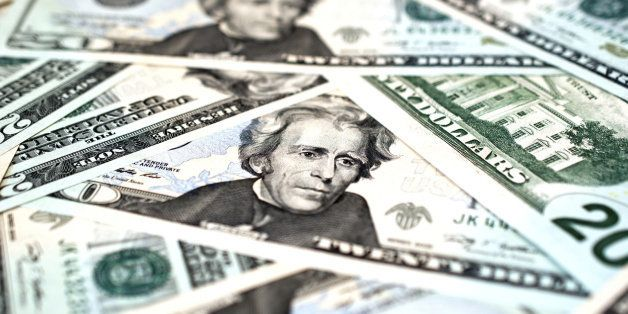 Macro shot of a pile of US$20 bills, showing the face of President Andrew Jackson