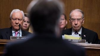 Chairman Charles Grassley, R-Iowa, and Sen. Orrin Hatch, R-Utah, listen to Judge Brett Kavanaugh during the Senate Judiciary Committee hearing on his nomination be an associate justice of the Supreme Court of the United States, on Capitol Hill in Washington, DC, U.S., September 27, 2018. Tom Williams/Pool via REUTERS