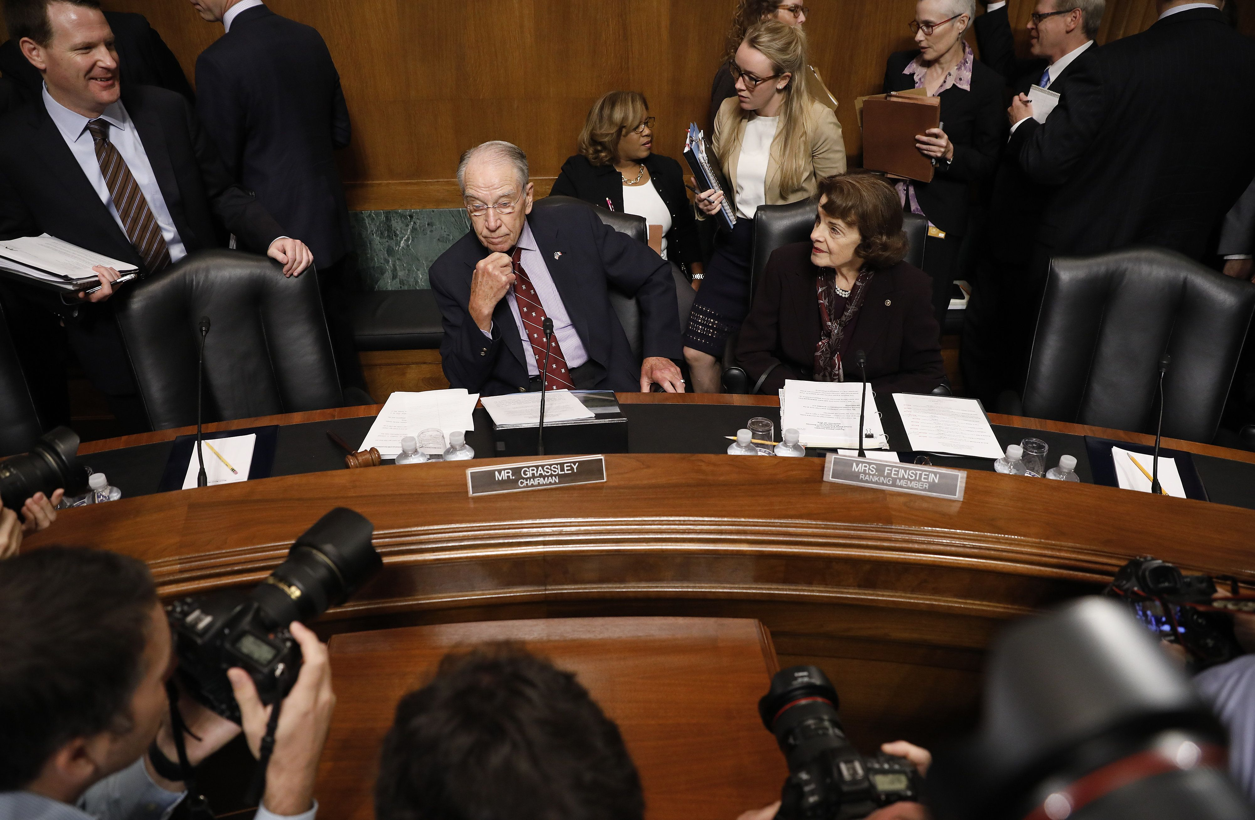 Senator Chuck Grassley, a Republican from Iowa and chairman of the Senate Judiciary Committee, center left, and Senator Dianne Feinstein, a Democrat from California and ranking member of the Senate Judiciary Committee, center right, arrive for a markup hearing in Washington, D.C., U.S., on Friday, Sept. 28, 2018. Supreme Court nomineeBrettKavanaughappears headed toward approval by the Senate Judiciary Committee after pivotal GOP SenatorJeff Flakesaid he'll vote to confirm the nominee. Photographer: Aaron P. Bernstein/Bloomberg via Getty Images