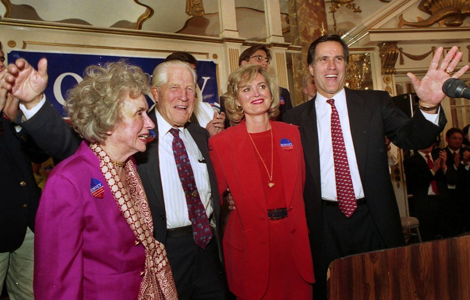 FILE - In this Feb. 2, 1994 file photo, Mitt Romney, right, chairman of the Boston-based management consulting firm Bain and