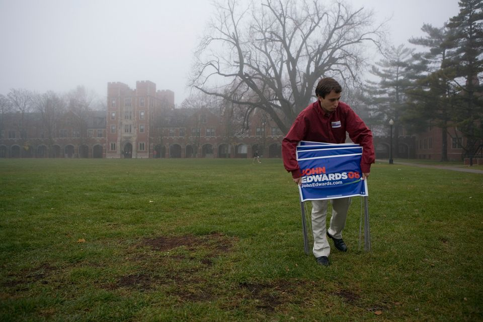 <em>IN THE PHOTO: GRINNELL, IA - NOVEMBER 20:  A campaign worker removes signs after a visit by former U.S. Senator and dem