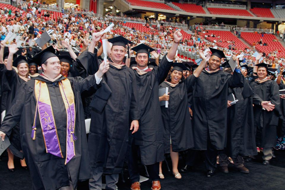 <em>GLENDALE, AZ - JUNE 29: Students show their excitement  during The University of Phoenix 2012 Graduation at University of