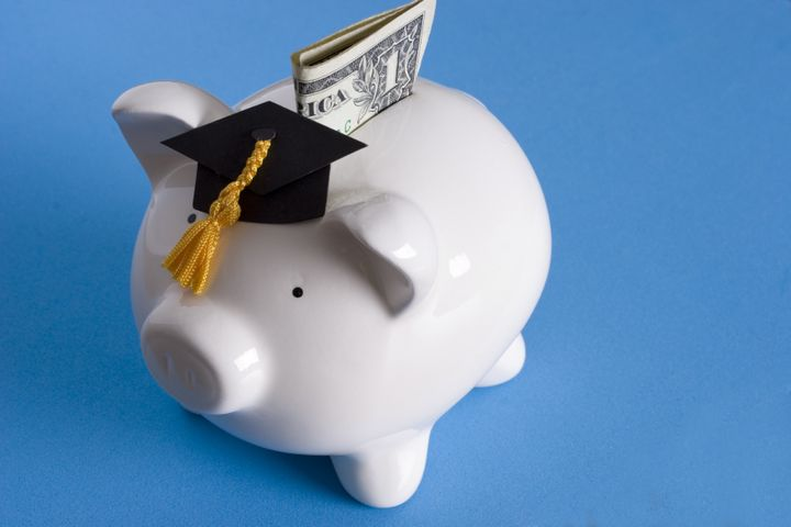 piggy bank with a graduation...