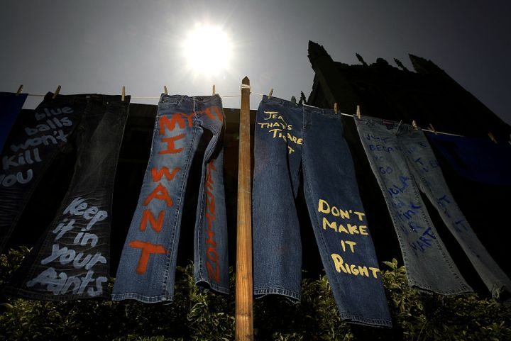 LOS ANGELES - APRIL 21: Blue jeans with messages challenging misconceptions about sexual violence are hung by the UCLA Clothesline Project on the University of California Los Angeles campus during Denim Day April 21, 2004 in Los Angeles, California. The UCLA Clothesline Project is a student organization which works to stop gender-based violence. In 1999, wearing jeans on Denim Day during Sexual Assault Awareness Month became an international symbol of protest against rape in response to an Italian Supreme Court decision, which overturned a rape conviction because the victim wore jeans. The Italian Court justices reasoned that the victim must have helped her attacker remove her jeans because they believed that without the victim's help, removing the jeans would be impossible. (Photo by David McNew/Getty Images)
