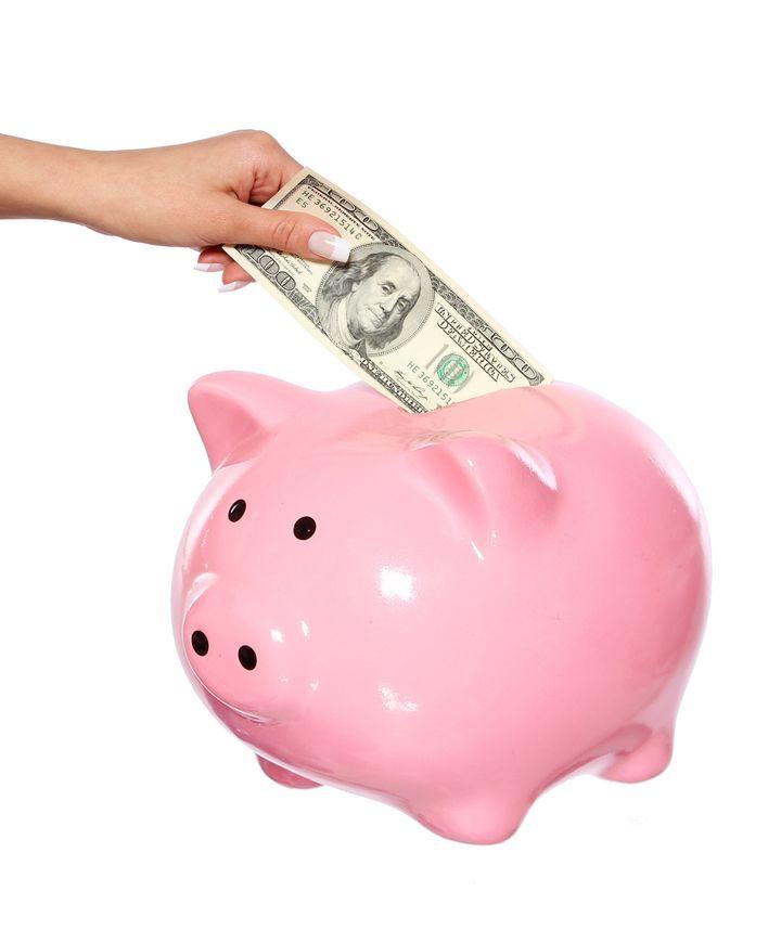 saving money  hand is putting...