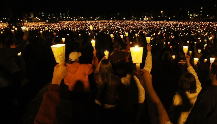 BLACKSBURG, VA - APRIL 16:  Mourners participate in a candlelight vigil on Virginia Tech's Day of Remembrance honoring the 32