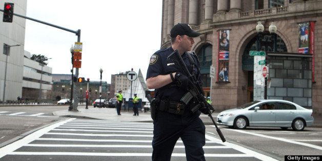 BOSTON, MA - APRIL 19:  A swat team member scouts the perimeter of South Station on April 19, 2013 in Boston, Massachusetts.