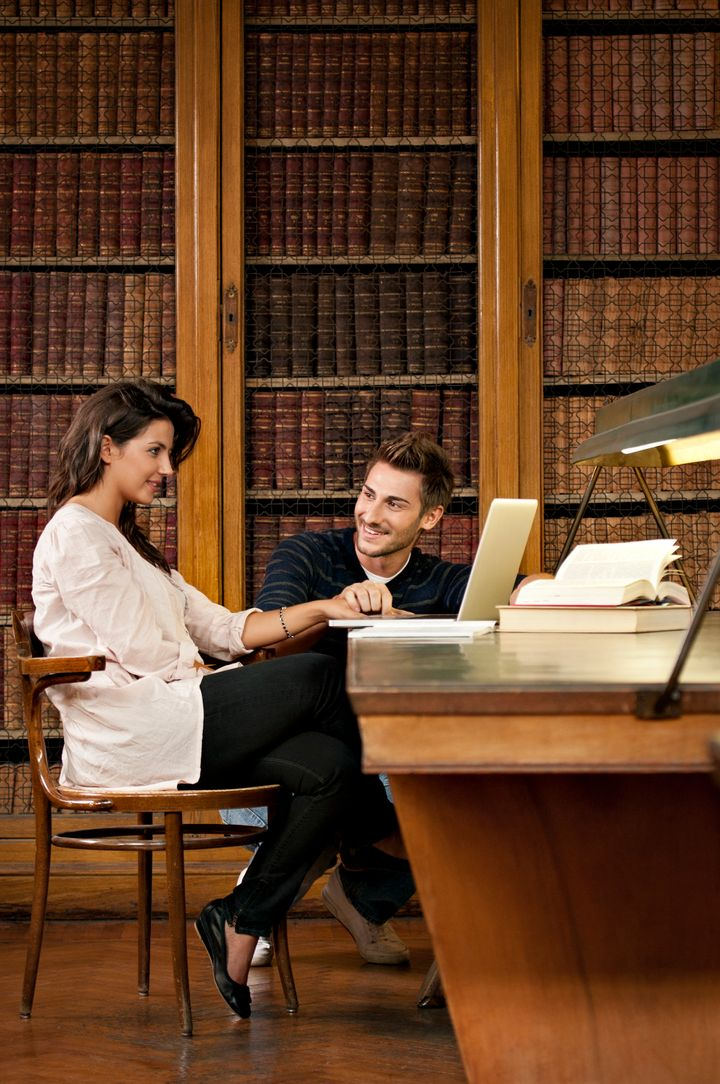 Students flirting in the library