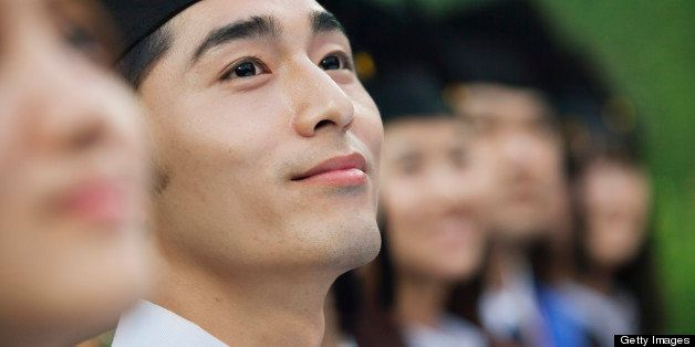 Chinese graduates in caps and gowns
