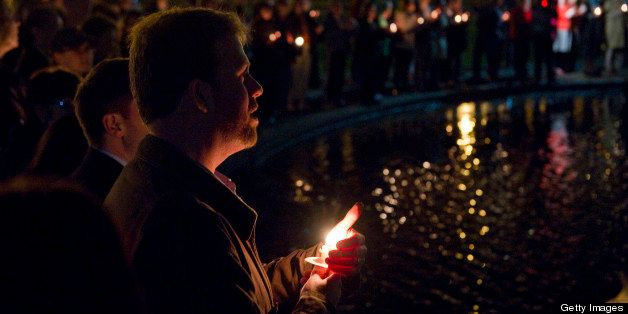 BOSTON, MASSACHUSETTS - APRIL 16: Mourners of the victims of the Boston Marathon explosion gather, light candles and sing in