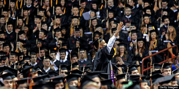 A University of South Carolina graduate looks to his family during the school's commencement ceremony in Columbia, South Caro