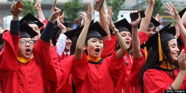 BOSTON - MAY 19: Graduates, including Tong Zhang, center, cheer during the presentation and promotion of candidates as Boston
