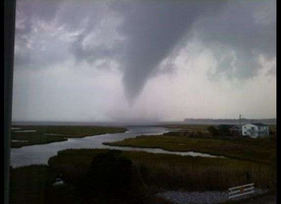 In this photo provided by Cathy Pasquariello, a storm cloud approaches Ocean City, Md. on Thursday, Sept. 15, 2011. The Natio