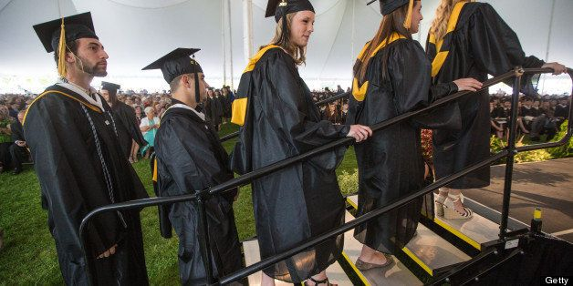 FRAMINGHAM - MAY 19: Graduates lined up to receive their diplomas at Framingham State University's commencement ceremony on M