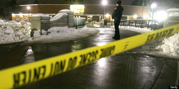 UNITED STATES - FEBRUARY 14:  A police officer stands guard at his post beyond crime-scene tape outside Cole Hall on the camp