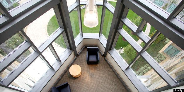 Furniture sits in a lounge on the first level of the faculty offices at the MIT Sloan School of Business Management's new bui