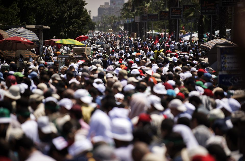 Thousands of Islamists and Muslim Brotherhood supporters attend the Friday prayers as they gather at Rabaa al-Adawiya mosque