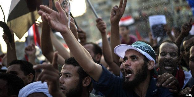 Muslim Brotherhood members and supporters of deposed president Mohammed Morsi shout slogans during a rally outside Rabaa al-A
