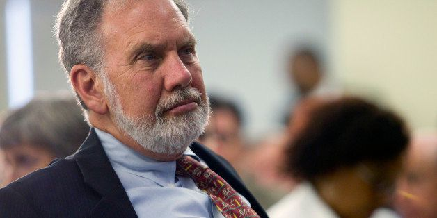 John Sexton, president of New York University, listens to Timothy Geithner, U.S. treasury secretary, at NYU in New York, U.S.
