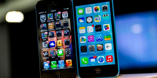 The home screen of an Apple Inc. iPhone 5 operating iOS 6, left, and an iPhone 5C operating iOS 7 is displayed in San Francis