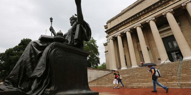 NEW YORK, NY - JULY 01:  People walk past the Alma Mater statue on the Columbia University campus on July 1, 2013 in New York