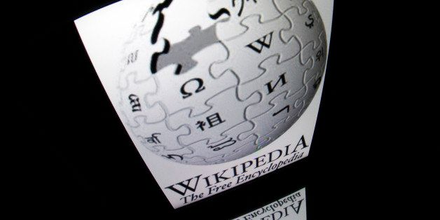 The 'Wikipedia' logo is seen on a tablet screen on December 4, 2012 in Paris. AFP PHOTO / LIONEL BONAVENTURE        (Photo cr