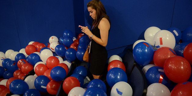 A girl uses her mobile phone at the Republican National Convention (RNC) in Tampa, Florida, U.S., on Thursday, Aug. 30, 2012.