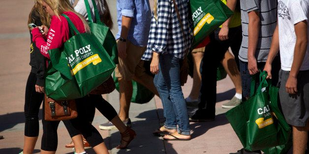 New students carry bags during orientation on the campus of California Polytechnic State University San Luis Obispo (Cal Poly SLO) in San Luis Obispo, California, U.S., on Friday, Sept. 20, 2013. Universities often are susceptible to the Interfraternity Conferences pressure to recruit freshmen because Greek life appeals to applicants and many alumni donors remain loyal to their fraternities. Photographer: Patrick T. Fallon/Bloomberg via Getty Images