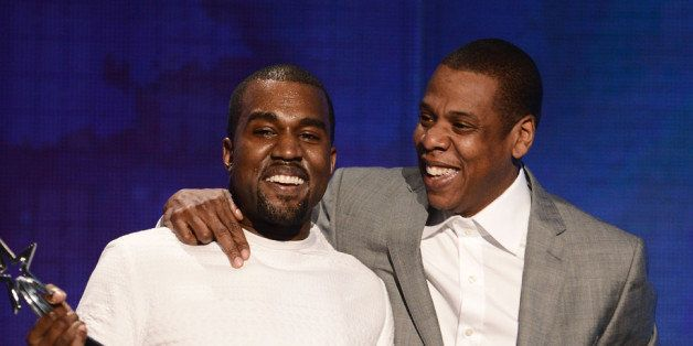 LOS ANGELES, CA - JULY 01:  Recording artists Kanye West (L) and Jay-Z accept the  Best Group Award onstage during the 2012 B
