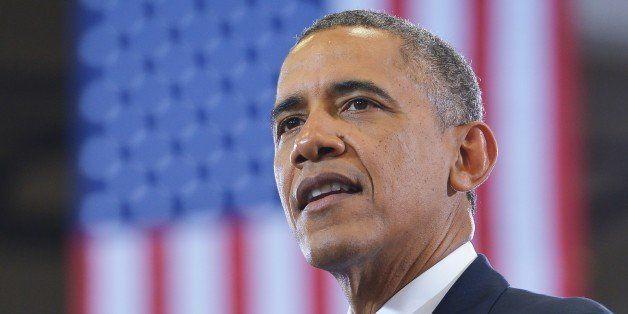 US President Barack Obama speaks at MacGavock High School in Nashville, Tennessee on January 30, 2014. AFP PHOTO/Mandel NGAN