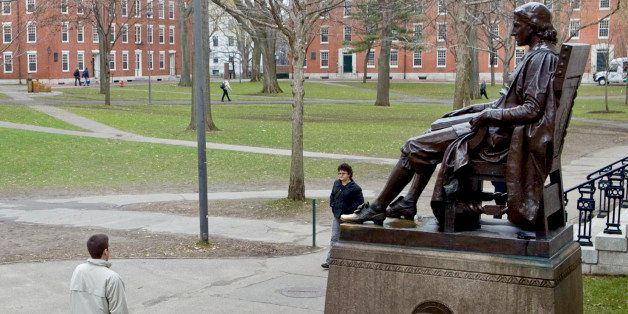 A statue of John Harvard sits in Harvard Yard on the school's campus in Cambridge, Massachusetts, U.S., on Tuesday, Dec. 15,