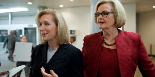 UNITED STATES - Nov 20: Sen. Kristen Gillibrand, D-NY., and Se. Claire McCaskill, D-MO., talk with reporters as they arrive a