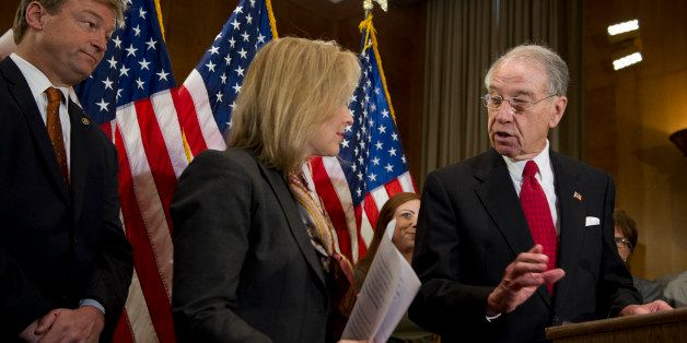UNITED STATES - Nov 19:  Sen. Dean Heller, R-NV., Sen. Kirsten Gillibrand, D-NY., and Sen. Charles Grassley, R-IA., during a