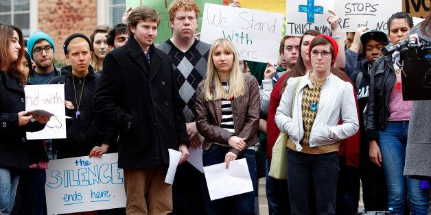 University of North Carolina-Chapel Hill sophomore Landen Gambill, center, stands with supporters during a rally Friday, Marc