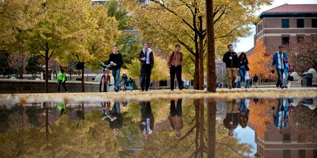 Students walk on the Purdue Mall on the campus of Purdue University in West Lafayette, Indiana, U.S., on Monday, Oct. 22, 201