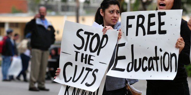 Students shout slogans while holding placards during a protest at the California State University of Los Angeles campus on Ma