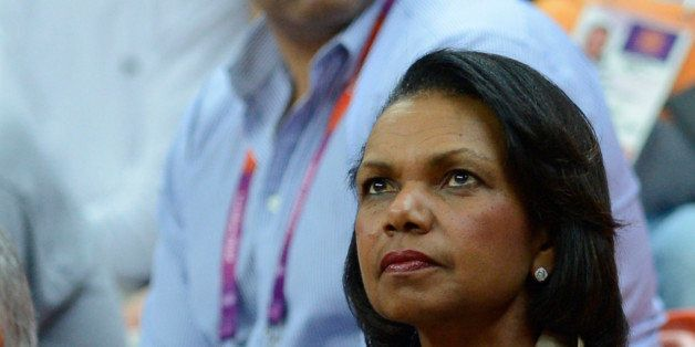 US former state secretary Condoleeza Rice watches the men's basketball preliminary round match Spain vs Brazil as part of the